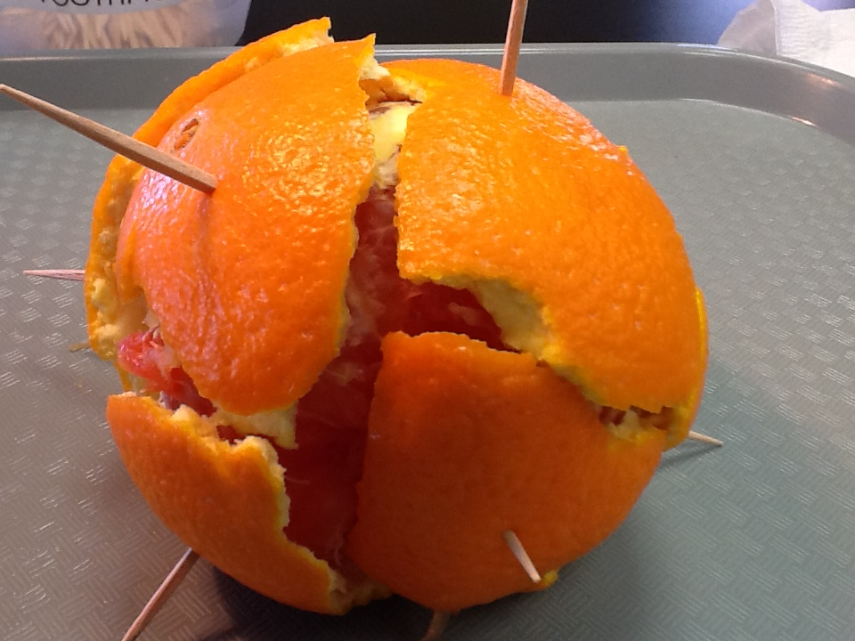 orange with toothpicks