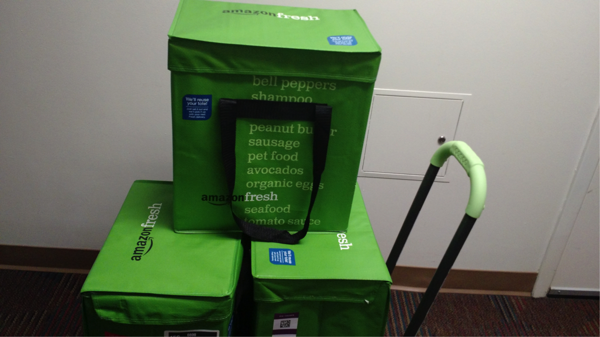 Photo of three Amazon coolers delivered on a hand-cart.