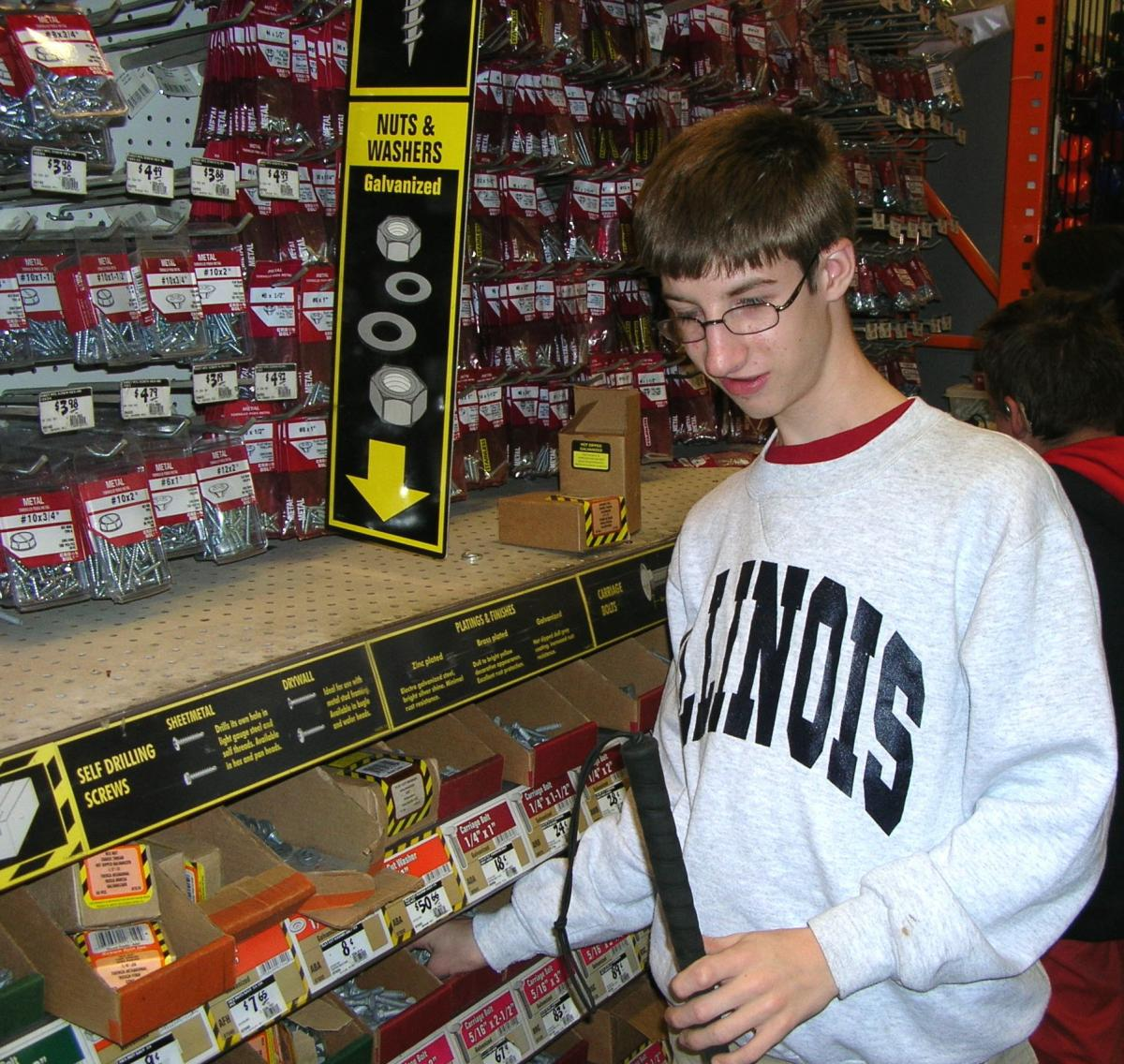 student shopping at hardware store