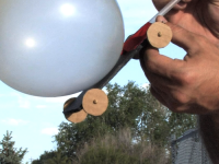 balloon attached to cardboard with wheels