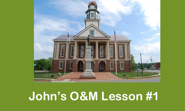 """Image of Pittsboro's Historic courthouse with text, """" John's O&M Lesson #1"""""""
