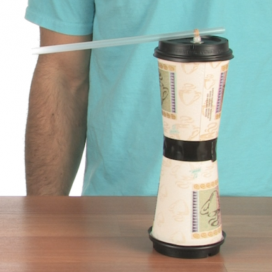 two cups stacked on top of each other with a straw attached