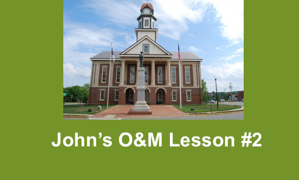 """Photo of Pittsboro Historic Courthouse and text, """"John's O&M Lesson #2"""""""