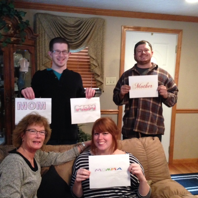 family holding mom signs