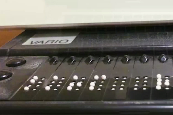 Close-up of a different refreshable braille display. The cells on this particular machine display 8-dot braille.