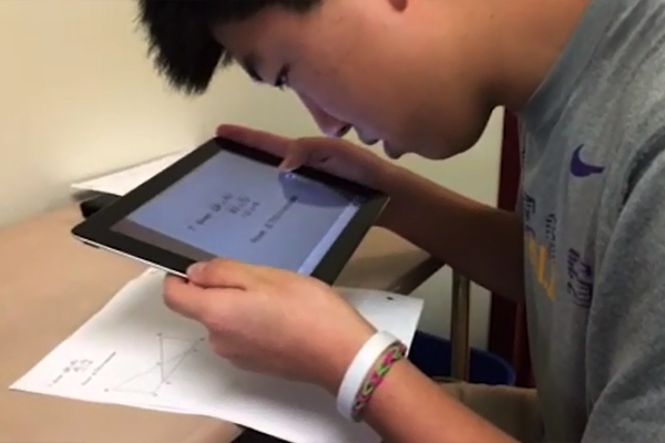 A student, who is visually impaired, taking screenshots of his geometry assignment with an app called EduCreations on his iPad.