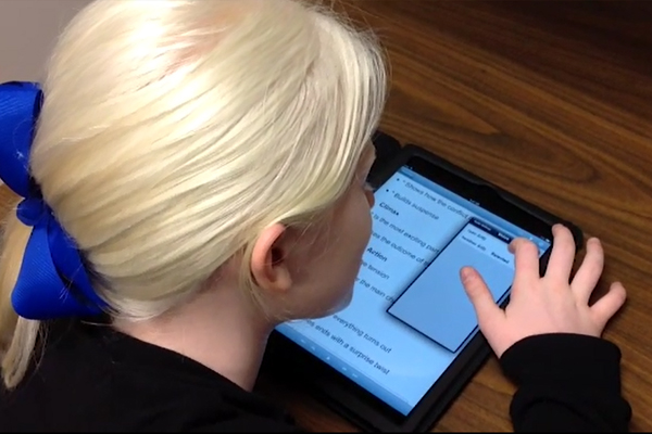 A young girl who is visually impaired demonstrating her proficiency with the iPad.