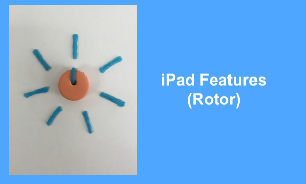 Using tactile representations to explain iPad concepts to a first grade blind student.