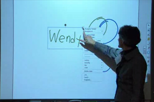 wendy writing her name on smartboard