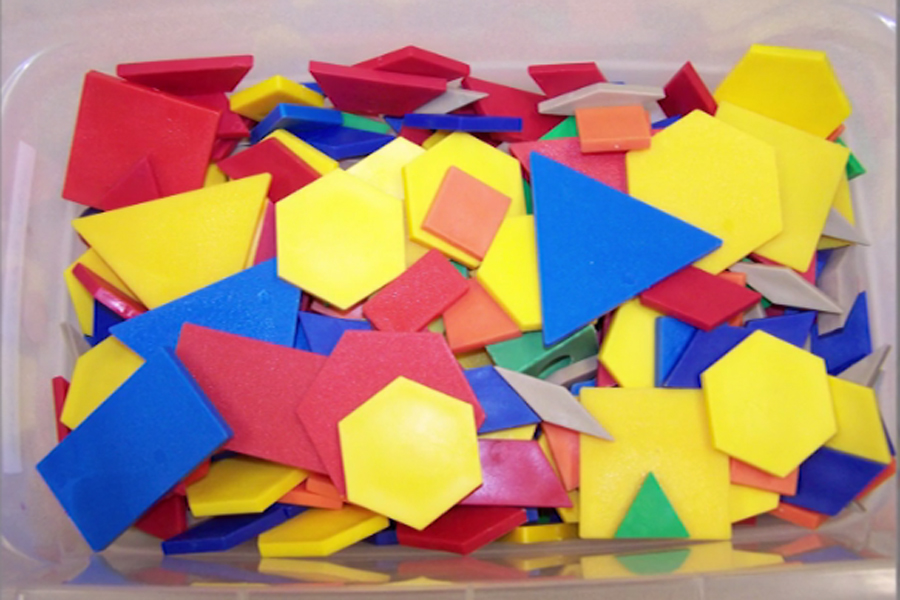 A bin of plastic pieces in various shapes, sizes, and colors.