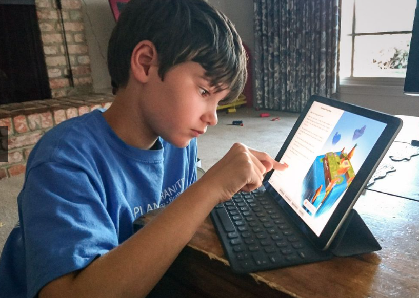 Elementary age student interacting with Swift Playgrounds app.