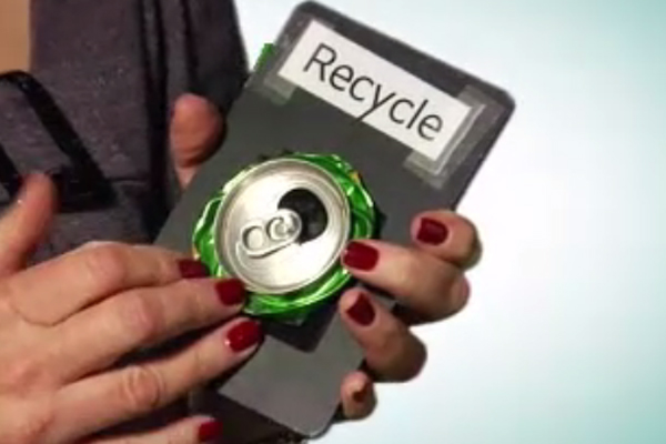 Sharon holds the object card labeled recycle with a symbolic object, a can for recycling.