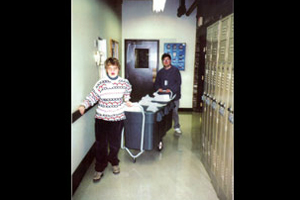 Two students working in a company and collecting the recycling.