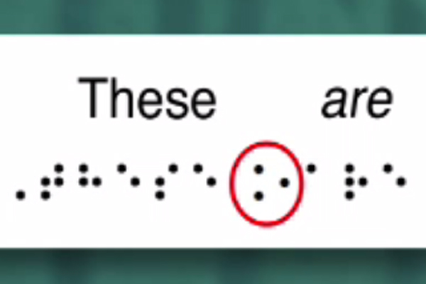A two dimensional UEB braille translation in which a symbol before the word are indicates the use of italics.