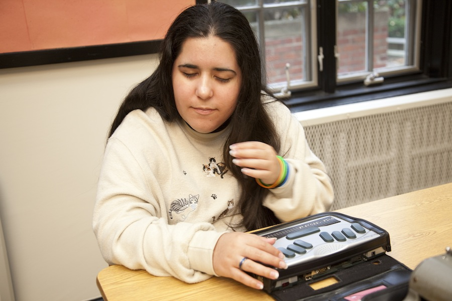Girl using braille notetaker
