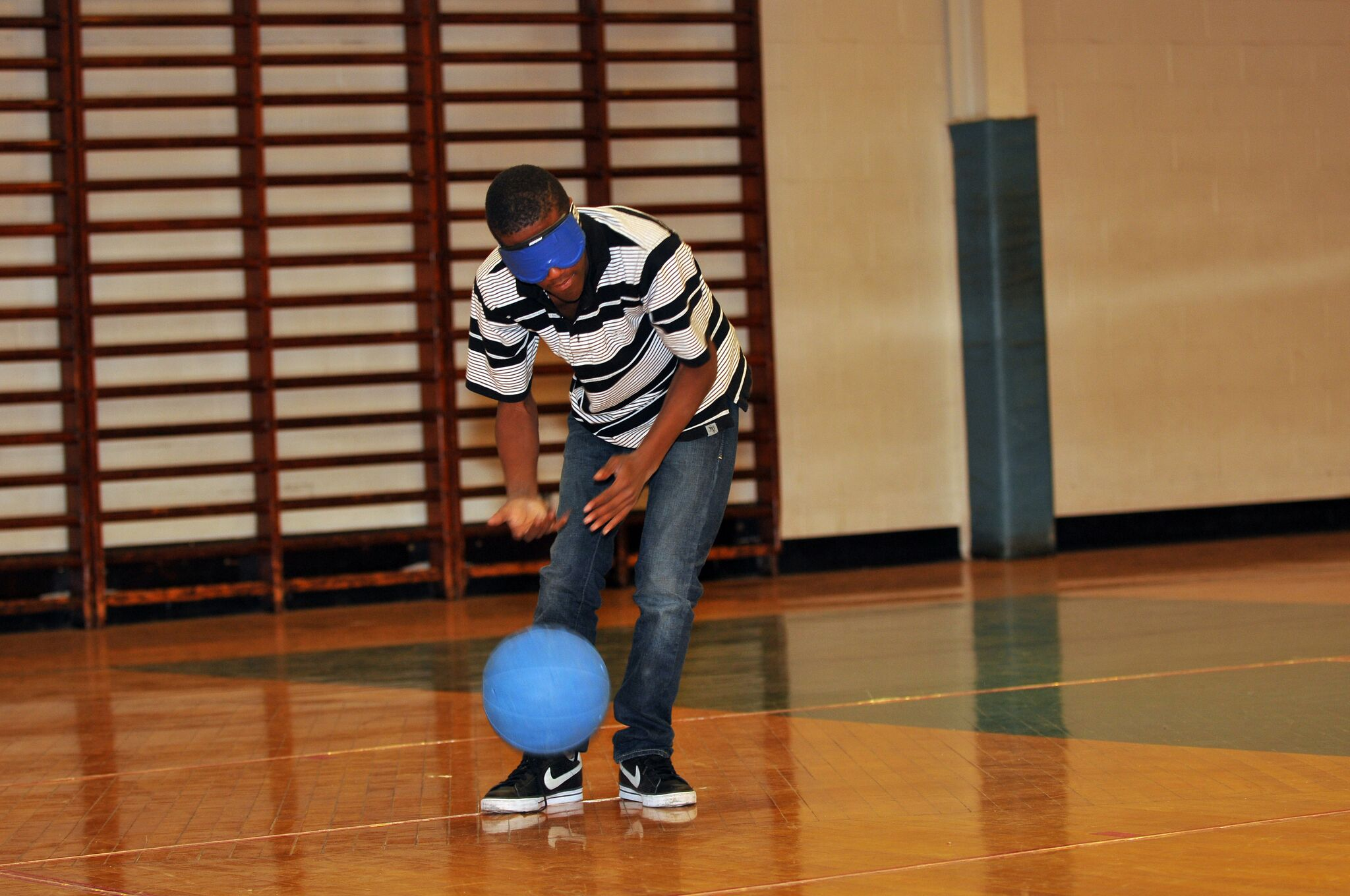 Teenager playing goalball
