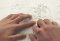 hands touching tactile graphic