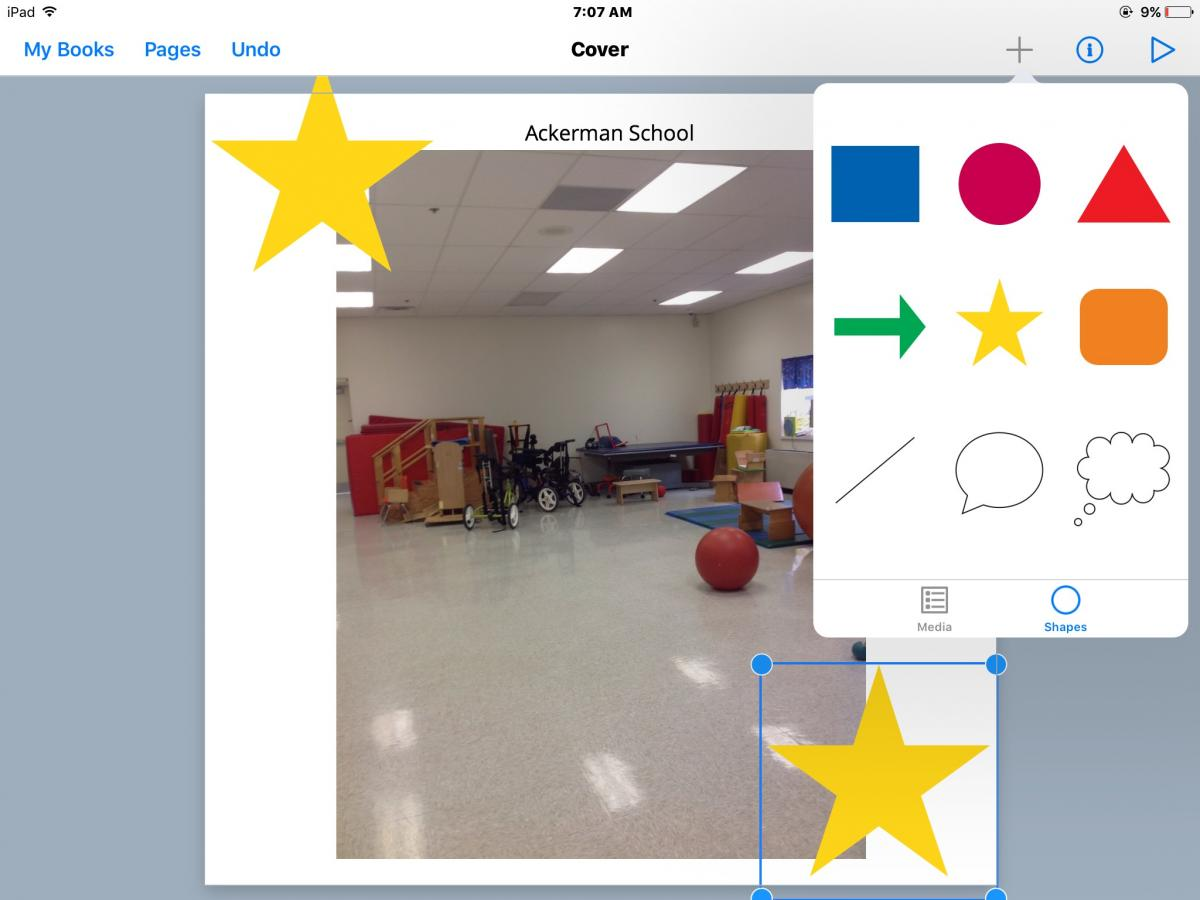 Book Creator app showing the cover image of a PT therapy room.  Author is adding a big yellow star to the top left & bottom right corners of the screen.