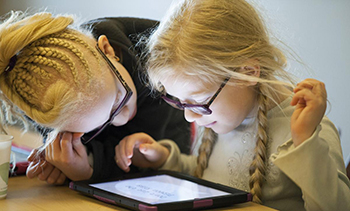 A student using an iPad