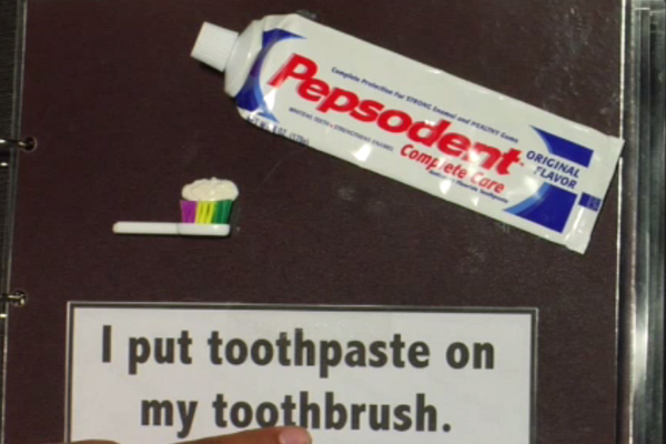 Illustration of I put toothpaste on my toothbrush.