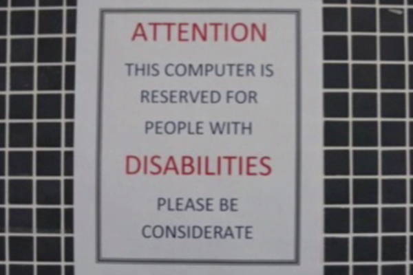 A sign at each computer work station.