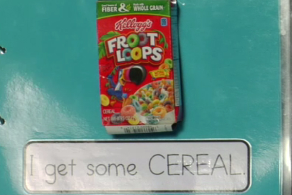 A cereal box with the word cereal brailled.