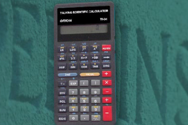 A photograph of the TI-34, a Texas Instruments talking calculator.