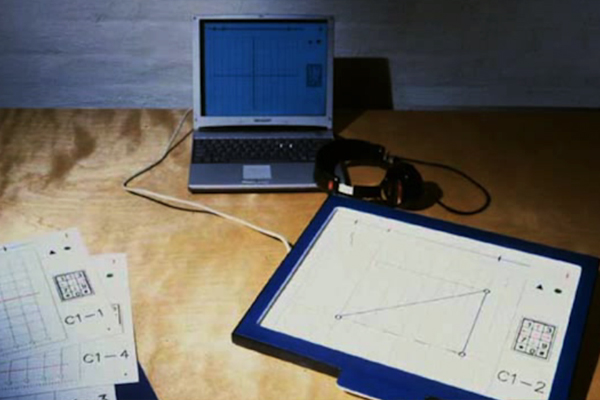 A raised-line graphic of a right triangle sits within the frame of a Talking Tactile Tablet.