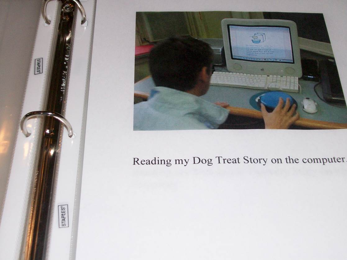 picture of student using a computer in a binder