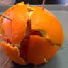 Orange with toothpicks in it
