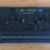 Photo of BrailleSense Polaris braille notetaker with 32 cell refreshable braille display and Perkins-style keyboard.