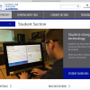 Screenshot of the Student Page of the Paths to Technology website; high school student using a magnified computer in his class.