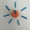 Tactile Rotor made out of a foam circle with a line (dial) and short pieces of Wikki-Styks flaring out like rays from the sun.