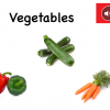 "Coverof the Vegetables book with pepper, zucchini, and carrots with the text ""Vegetables"" and red speaker icon."