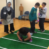 """student prepared to """"hike"""" the ball on green carpet"""