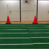 football green carpet with two cones on the end