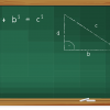 the pythagorean theorem written on a green chalkboard
