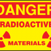 yellow sign with red writing that reads DANGER RADIOACTIVE MATERIALS