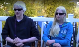 Two teenagers with albinism.