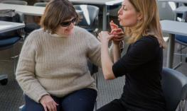Two women talking with sign language
