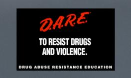 "Image of text: ""DARE to resist drugs and violence. Drug Abuse Resistance Education."""
