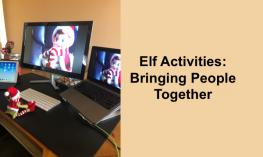 Photo of Elf in a Zoom Meeting - sitting on a desk in front of a keyboard with his image on the computer monitor.