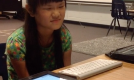 Image of Geneva with her iPad and Bluetooth keyboard