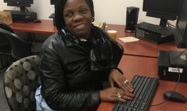Student using computer in Assistive Technology lab