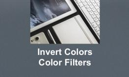 """Black and white photo of a corner of an iPad with text, """"Invert colors and Color filters"""""""