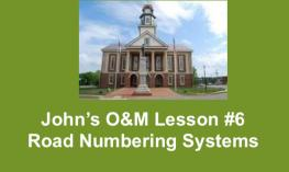 "Image of Pittsboro's historic courthouse and text, ""John's O&M lesson #6: Road Numbering Systems"""