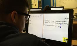 Student using Zoomtext to write notes in class.
