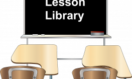"Image of two student desks in front of a blackboard with the words, ""lesson library"""
