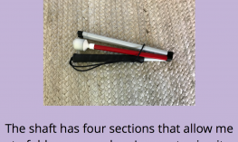 """Folded long cane with text, """"The shaft has 4 sections that allow me to fold my cane when I am not using it."""""""