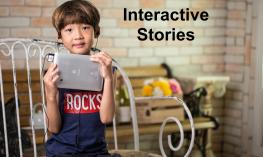 "Young boy with ear buds holding an iPad with text, ""Interactive Stories"""